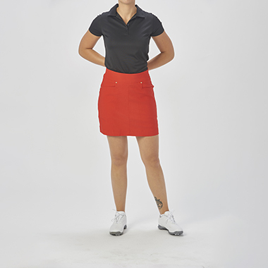 a_lady_wearing_a_skirt_and_a_golf_polo_needs_color_correction