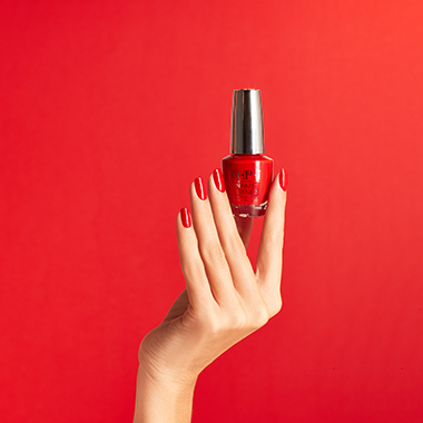 Skin retouching for a hand holding nail polish done by clipping path zone