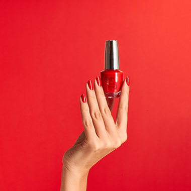Skin retouching required for a hand holding nail polish.